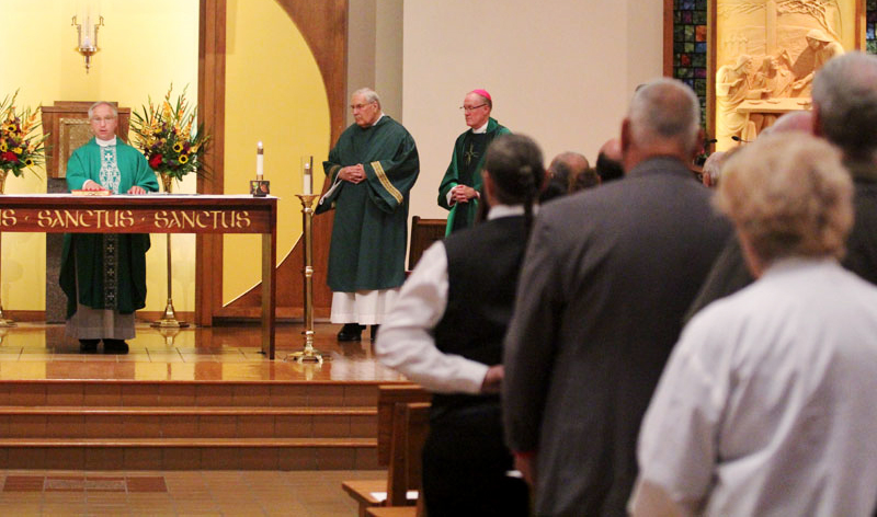 Fr Davis pledges his faith and fidelity