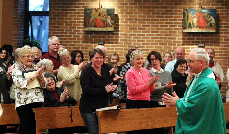 applause for the newly installed pastor