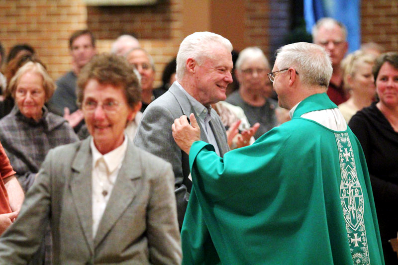 Fr Davis is greeted by representivies of the parish