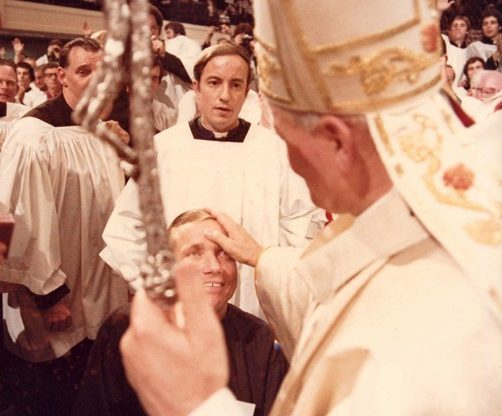 Augustinian Father William Atkinson, a lifelong Delaware County resident, in 1974 became the first quadriplegic priest to be ordained for the Catholic Church. Here, he is blessed by Pope John Paul II. (Photo courtesy  fatherbillatkinson.com)