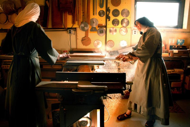 In this undated photo, a Poor Clare Colettine nun who is the novice mistress works with a novice in the wood shop at the religious order's Corpus Christi Monastery in Rockford, Ill. (CNS photo/Abbie Reese)