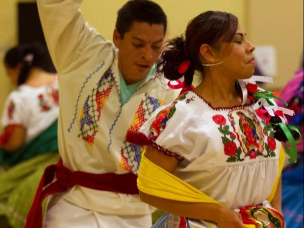 The image of Our Lady of Guadalupe is featured on the clothing of many of many of the dancers participating in an Oct. 30 event at Our Lady of the Valley Catholic Church in Caldwell, Idaho. (CNS photo/Chaz Muth)