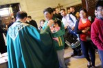 Father Thomas Viviano blesses families attending Hispanic Family Day at St. Charles Seminary Nov. 8. (Sarah Webb)