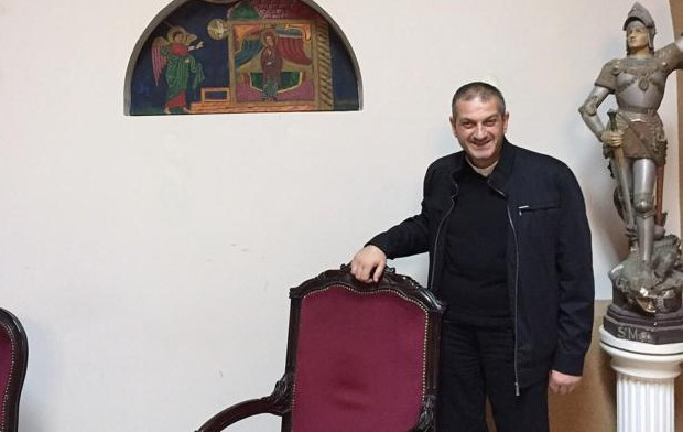 Father Jacques Mourad poses for a photo Nov. 11 in the reception area at Our Lady of the Annunciation Church in Beirut, Lebanon. (CNS photo/Doreen Abi Raad)