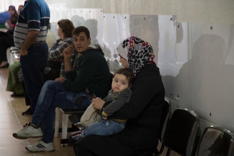 Patients wait for their turn to be treated at St. Anthony's medical dispensary in Beirut. The clinic, run by the Good Shepherd Sisters, functions as a primary health care center, serving Iraqi and Syrian refugees, as well as Lebanon's poor. (CNS photo/Dalia Khamissy) .
