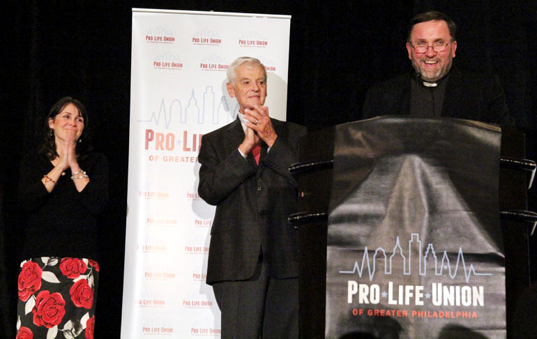 Edel Finnegan, Executive Director and Bill Wohlgemuth, President of ProLife Union of Greater Philadelphia and Fr. Chris Walsh emcee.