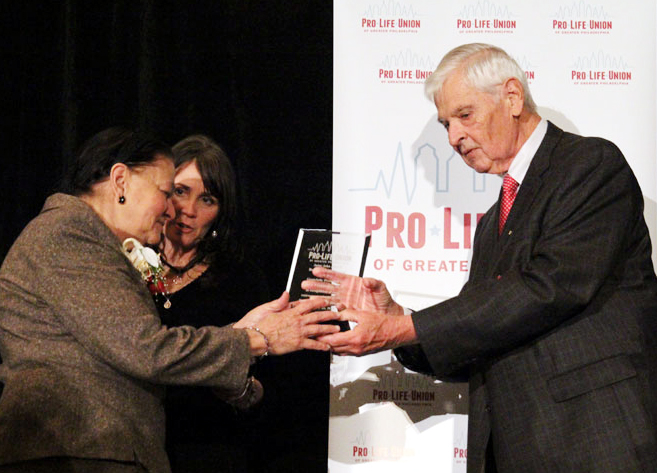 Edel Finnegan, Executive Director and Bill Wohlgemuth, President of ProLife Union of Greater Philadelphia present Dr. Doris Fernandes with the JPII Be Not Afraid Award.