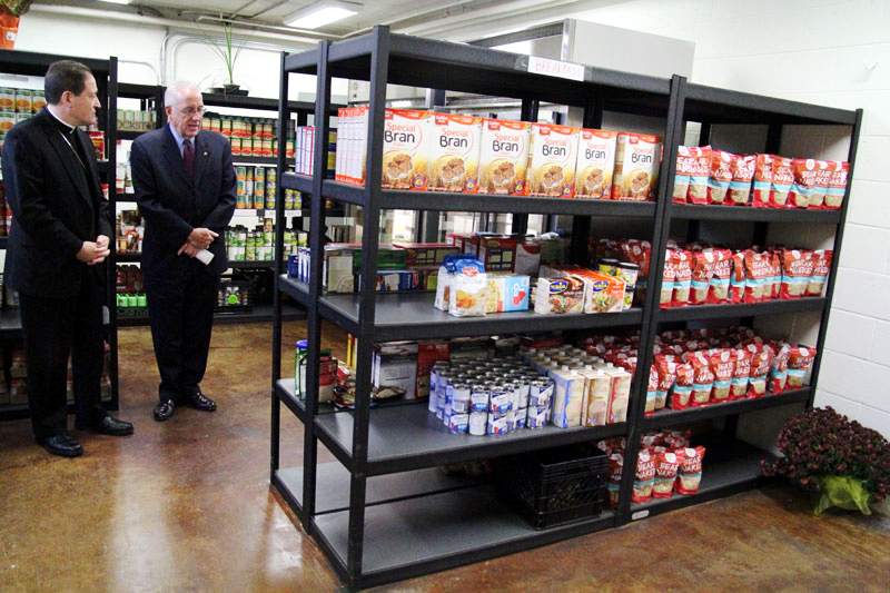 Bishop John McIntyre and Joseph Sweeney tour Martha's Choice Marketplace.