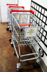 Small shopping carts are provided for children so they can shop for their own food along side their parents.