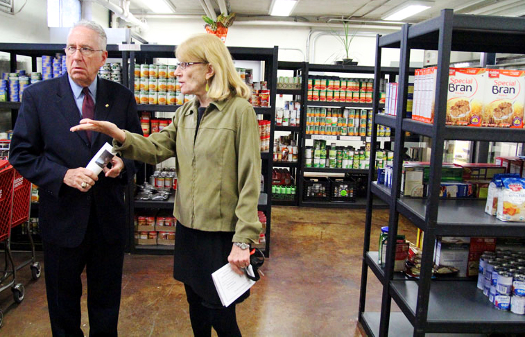 Joseph Sweeney and Anne Ayella tour Martha's Choice Marketplace.