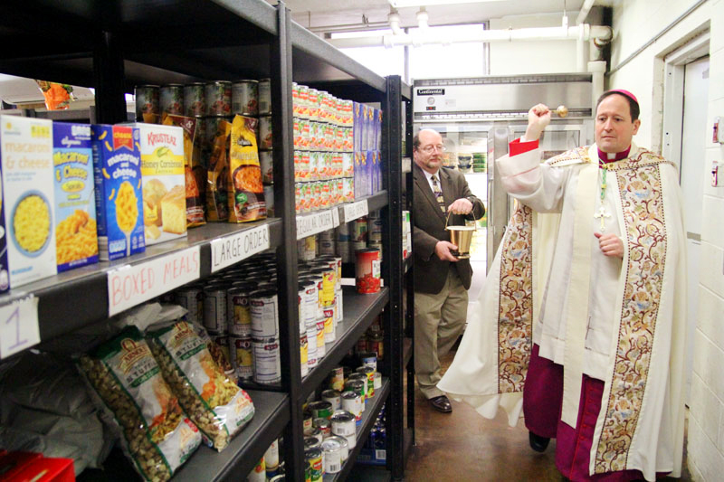 Bishop John McIntyre blesses the newly designed Martha's Choice Marketplace.