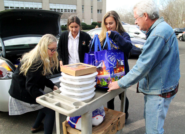 As the blessing was coming to an end students from Pope John Paul II High School arrived to deliver food the student collected for those in need.