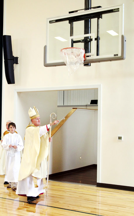 Bishop Michael Fitzgerald blesses the gym at Nativity of Our Lord Parish in Warminster.