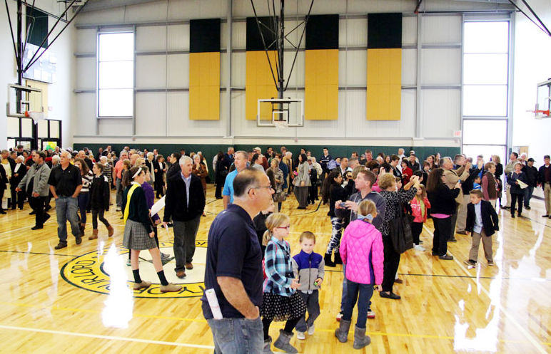 Parishioners and friends tour the new gym after the blessing.
