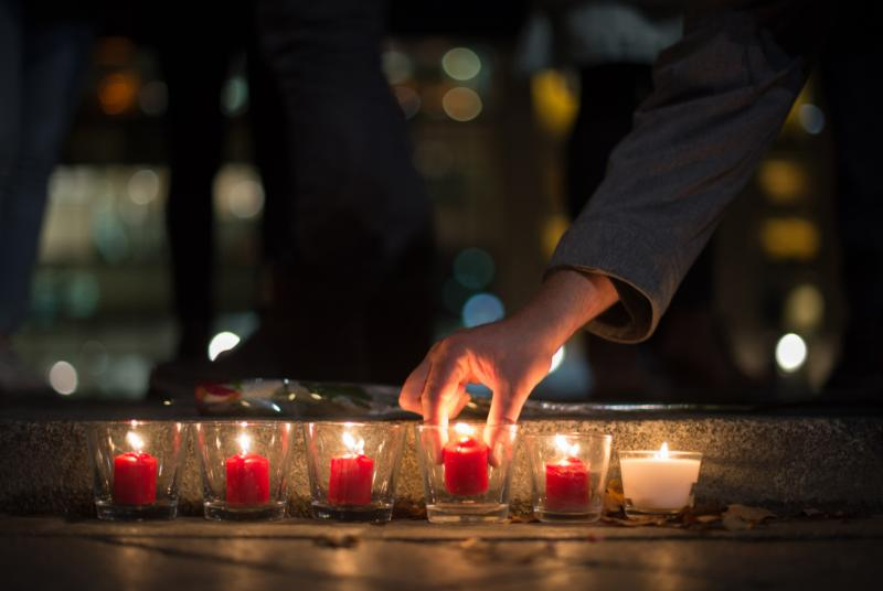 People light candles in tribute to the victims of the Paris attacks, outside the French Embassy in Berlin, Germany, Nov. 13. Dozens of people were killed in a series of attacks in Paris Nov. 13. (CNS photo/Lukas Schulze, EPA)