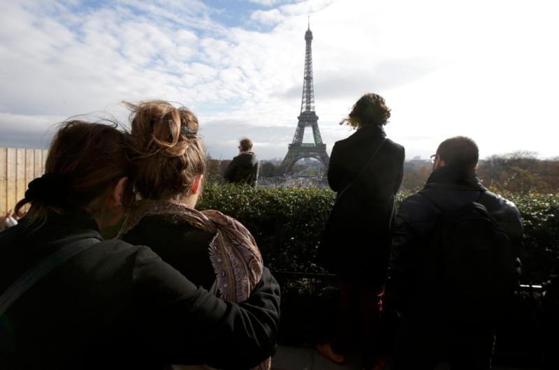 People observe a minute of silence at the Trocadero in Paris  Nov. 16. (CNS photo/Philippe Wojazer, Reuters)