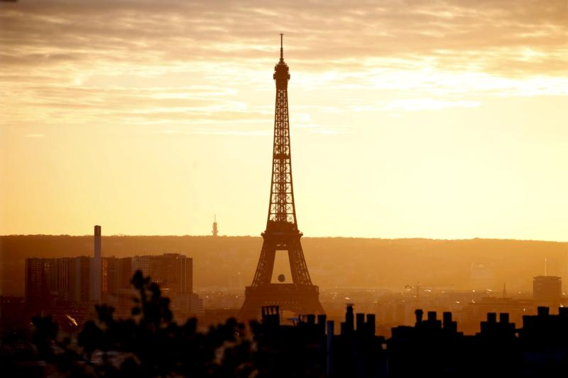 The Eiffel Tower is seen at sunset in Paris Nov. 22. Catholic organizations said the terror attacks in Paris had not dissuaded them from attending the U.N. climate change conference Nov. 30-Dec. 11. (CNS photo/Charles Platiau, Reuters)