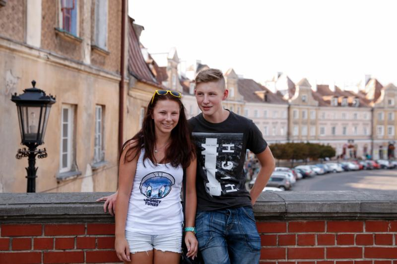 Young people pose for a photo on a bridge leading into the old town section of Lublin, Poland, Aug. 31. (CNS photo/Nancy Wiechec)