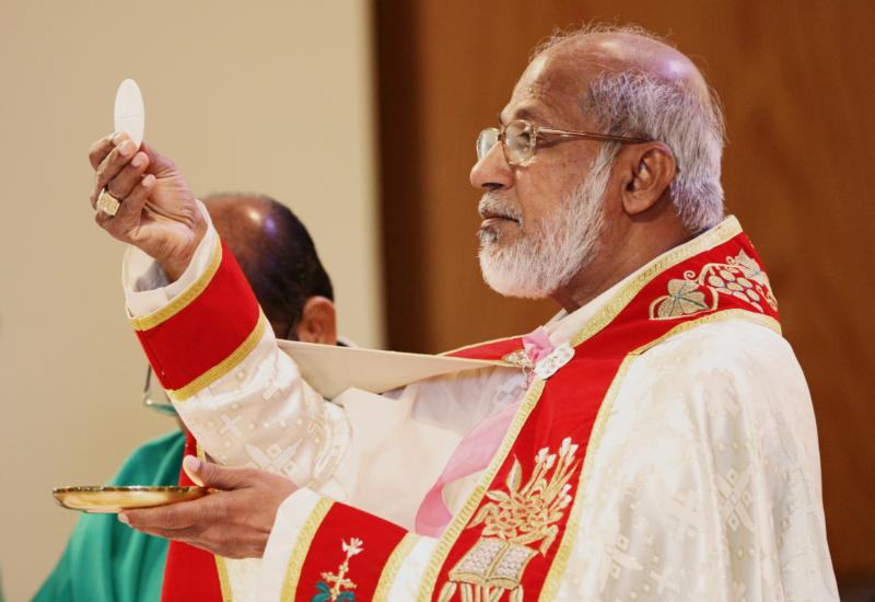 Cardinal George Alencherry of India, major archbishop of the Syro-Malabar Catholic Church, elevates the Eucharist during Mass in 2012 at Resurrection Church in Farmingville, N.Y. The Eucharist is not just a reward for the good, but also strength for the weak and nourishment for those who hunger for love, forgiveness and mercy, Pope Francis said. (CNS photo/Gregory A. Shemitz, Long Island Catholic)