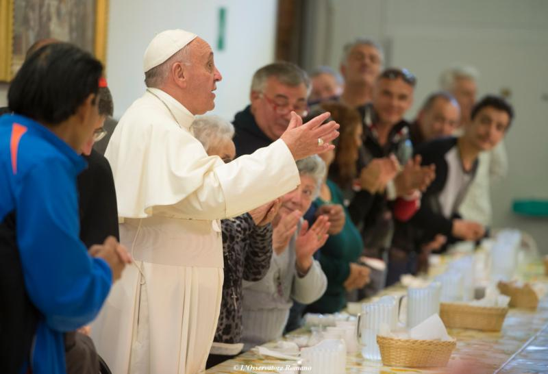 Pope Francis gestures during lunch with the poor at the Mensa di San Francesco Poverino, a charity center run by Caritas, in Florence, Italy, Nov. 10. (CNS photo/L'Osservatore Romano, handout)