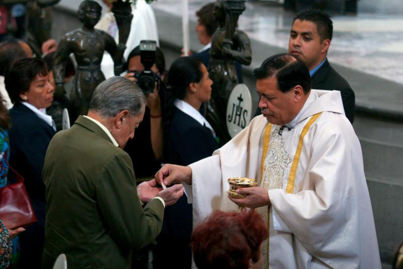 Cardinal Norberto Rivera Carrera of Mexico City distributes Communion during Mass in early May at Mexico City's Metropolitan Cathedral. Pope Francis will visit Mexico in February, marking the pontiff's first trip to the heavily Catholic country, said Cardinal Rivera. (CNS photo/Ricardo Castelan, EPA)