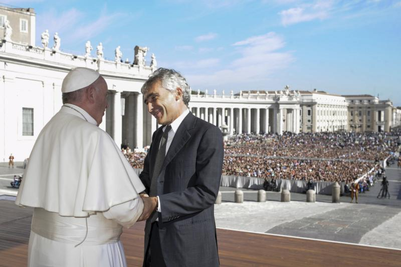 Pope Francis shakes hands with Tito Boeri, president of Italy's National Institute of Social Welfare, during an audience with members of the Italian National Social Security Institute in St. Peter's Square at the Vatican Nov. 7. The institute oversees the government's disability and pension structure. (CNS photo/L'Osservatore Romano, via Reuters)