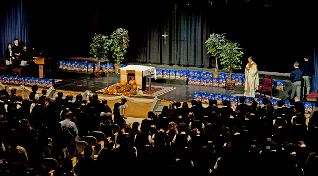 The bags that students delivered to local parishes and agencies sit on the stage at Pope John Paul II High School during the Nov. 24 Mass preceding the deliveries.