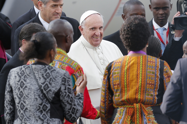 Pope Francis smiles as he is welcomed by guests after landing at Jomo Kenyatta International Airport in Nairobi, Kenya, Nov. 25. (CNS photo/Dai Kurokawa, EPA)