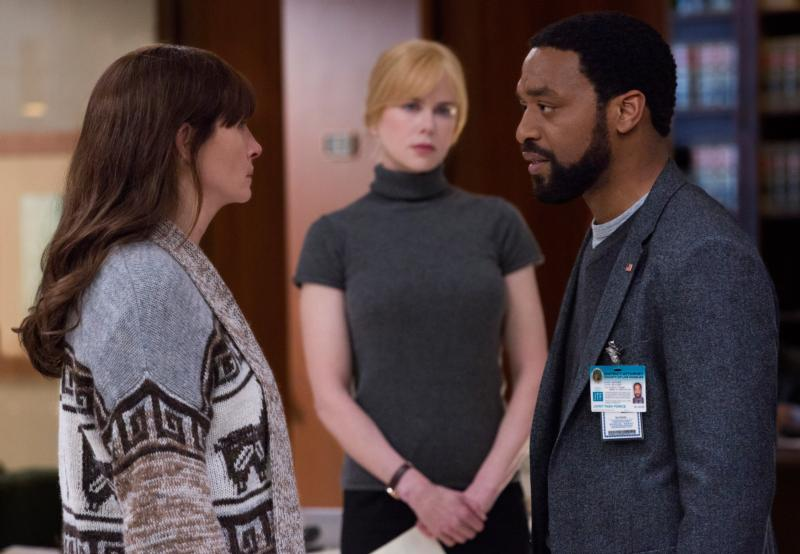 "Julia Roberts, Nicole Kidman and Chiwetel Ejiofor star in a scene from the movie ""Secret in Their Eyes.""  (CNS photo/STX)"