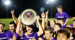 Roman Catholic's soccer team hoists the Catholic League trophy Nov. 1 at Archbishop Ryan High School. (Sarah Webb)