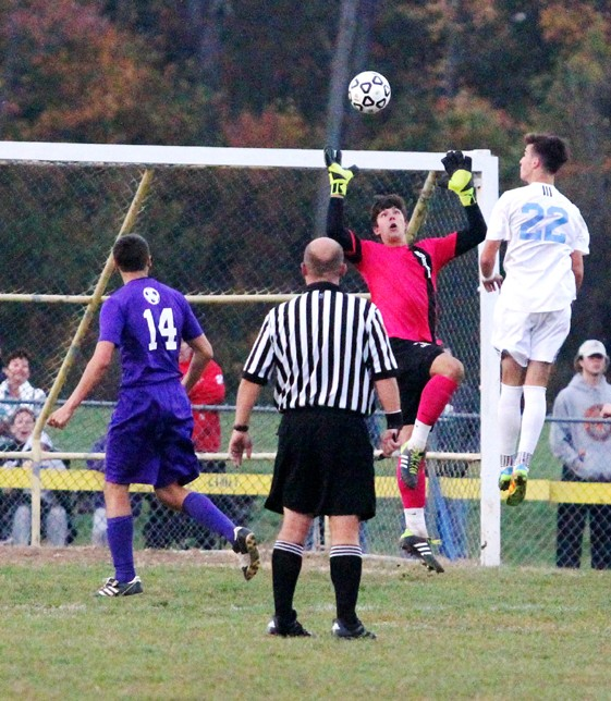 Roman senior goalie Mark Tobin makes one of many saves. (Sarah Webb)