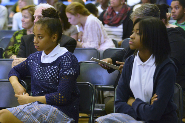 Students listen to presentations at Gesu School's 2015 symposium.