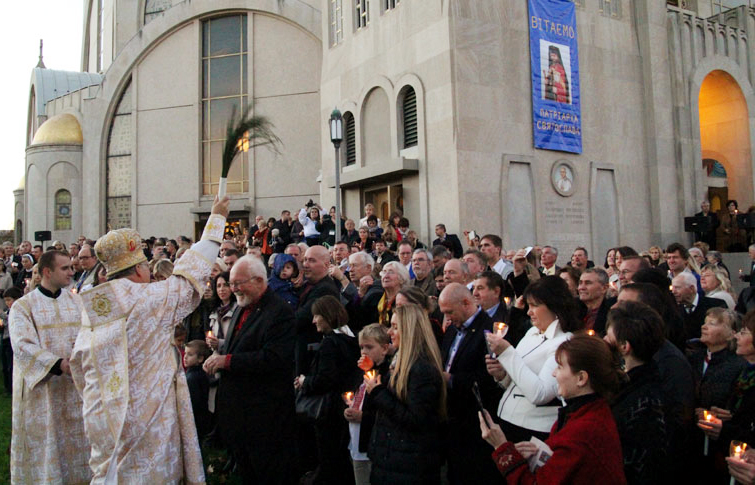 Metropolitan Archbishop Most Reverend Stefan Soroka blesses the crowd after the blessing of the bell tower.