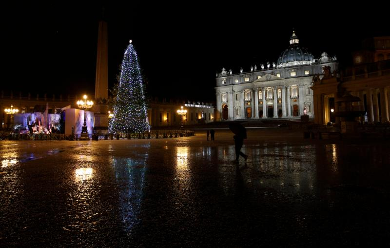 The St. Peter's Square Christmas tree is reflected in a puddle of slush after a five-minute hail storm hit the Vatican Feb. 1. (CNS photo/Paul Haring)