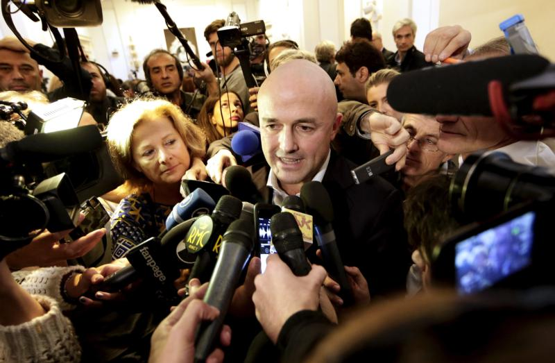 "Italian journalist Gianluigi Nuzzi is surrounded by the media after a Nov. 4 news conference for his new book ""Merchants in the Temple: Inside Pope Francis' Secret Battle Against Corruption in the Vatican."" (CNS photo/Yara Nardi, Reuters)"