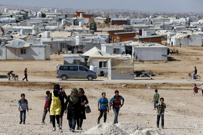 Syrian refugees walk at Zaatari refugee camp in the Jordanian city of Mafraq, near the border with Syria, Nov. 1. (CNS photo/Muhammad Hamed, Reuters)