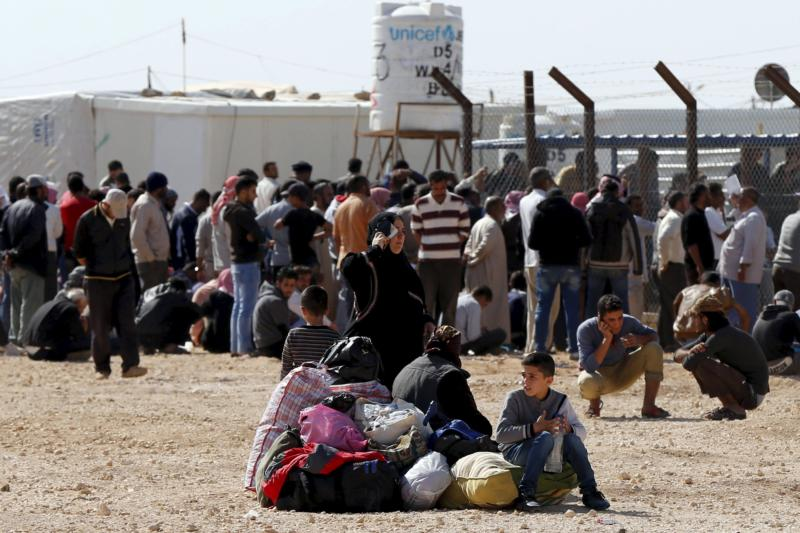 Syrians refugees at the Zaatari refugee camp Nov. 1 wait to register their names to return to their homeland in Syria. The U.N. refugee agency reports that currently about 100 Syrians return home nearly every day from Jordan. (CNS photo/Muhammad Hamed, Reuters)