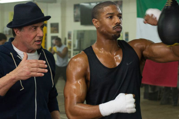 "Sylvester Stallone and Michael B. Jordan star in a scene from the movie ""Creed."" The Catholic News Service classification is A-III -- adults. The Motion Picture Association of America rating is PG-13 -- parents strongly cautioned. Some material may be inappropriate for children under 13. (CNS photo/Warner Bros.)"