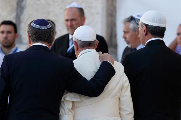 "Pope Francis walks with Argentine Rabbi Abraham Skorka, left, and Omar Abboud, a Muslim leader from Argentina, as he leaves after praying at the Western Wall in Jerusalem in this May 26, 2014, file photo. In his official proclamation of the Holy Year of Mercy, Pope Francis called for ""fervent dialogue"" between Christians, Muslims and Jews. (CNS photo/Paul Haring)"