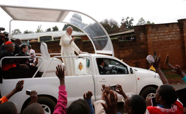 Pope Francis arrives to visit a Catholic parish in the Kangemi slum on the outskirts of Nairobi, Kenya, Nov. 27. (CNS photo/Paul Haring)