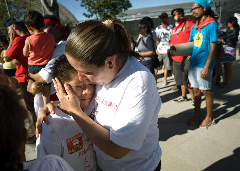 Daniel Hernandez gets a hug from his mother, Maria Puga, during an Aug. 16, 2014, rally to mark the end of the Trail for Humanity immigrant rights caravan in San Diego.(CNS photo/David Maung, EPA)