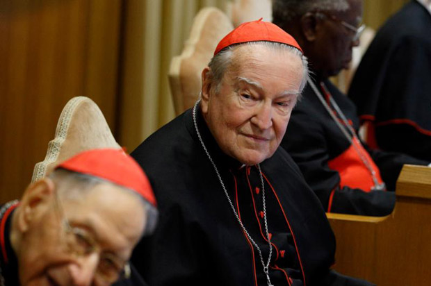 "Italian Cardinal Andrea Cordero Lanza di Montezemolo, center, attends a conference on ""Gaudium et Spes"" at the Vatican Nov. 5. At left is Swiss Cardinal Georges Cottier and at right Nigerian Cardinal Francis Arinze. (CNS photo/Paul Haring)"
