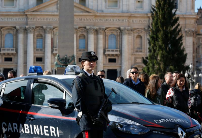 A member of the Carabinieri, the Italian military police force, stands guard as people leave Pope Francis' Angelus blessing in St. Peter's Square at the Vatican Nov. 22. (CNS photo/Paul Haring)