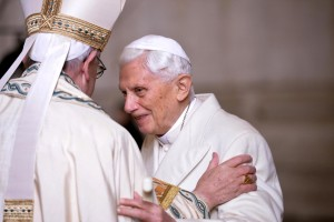 Pope Francis greets retired Pope Benedict XVI prior to the opening of the Holy Door of Saint Peter's Basilica at the Vatican Dec. 8. Pope Francis opened the Holy Door to inaugurate the Jubilee Year of Mercy. (CNS photo/Maurizio Brambatti, EPA) See POPE-MERCY-DOOR Dec. 8, 2015.