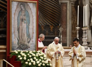 Pope Francis uses incense to venerate an image of Our Lady of Guadalupe during Mass marking the feast of Our Lady of Guadalupe in St. Peter's Basilica at the Vatican Dec. 12. (CNS photo/Paul Haring)