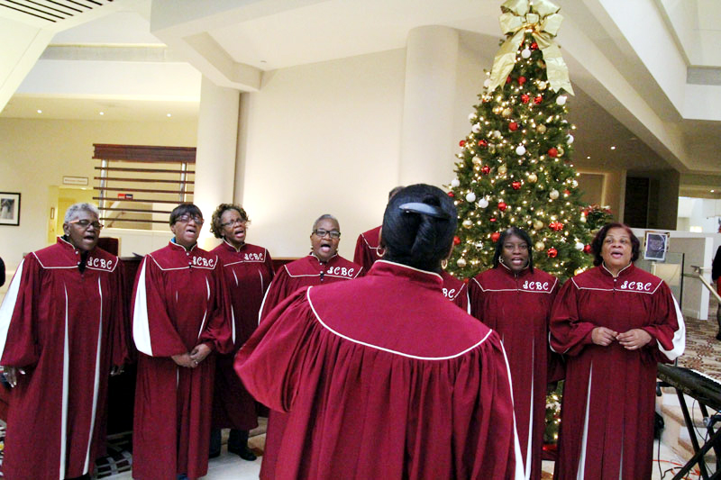 Saint Charles Borremeo Choir perform in the lobby as children arrive.
