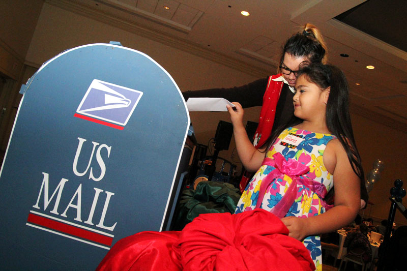 Children were able to drop the letters they wrote to Santa in an oversized mailbox.