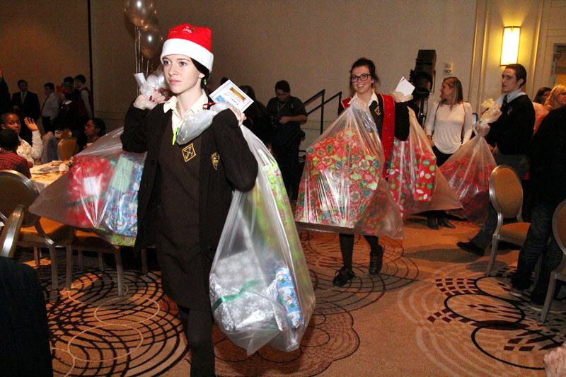 HIgh school students from across the Archdiocese served as Santa's helper for the day.