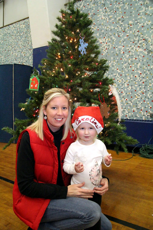 Caroline Coulbourn enjoys the Christmas celebration with her mom Kerry.
