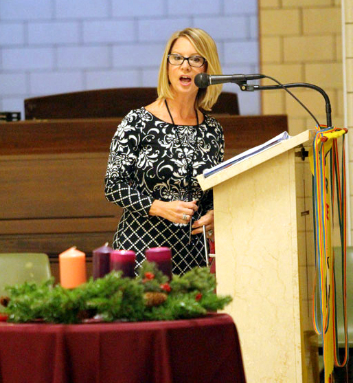 Director of the leader school, Kellyanne Patterson, welcomes everyone to the anniversary mass.